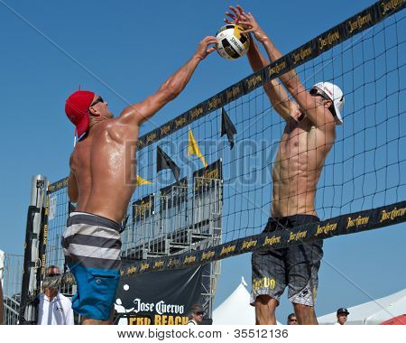 HERMOSA BEACH, CA - JULY 21: Sean Scott and Bartosz Bachorski compete in the Jose Cuervo Pro Beach Volleyball tournament in Hermosa Beach, CA on July 21, 2012.