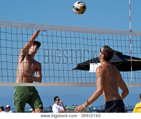 HERMOSA BEACH, CA - JULY 21: Jeremy Casebeer and Ryan Doherty compete in the Jose Cuervo Pro Beach Volleyball tournament in Hermosa Beach, CA on July 21, 2012.