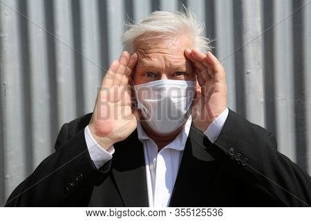Coronavirus outbreak. COVID-19. A man wears a Paper Face Mask to avoid contamination of the dreaded Coronavirus2019. Global Pandemic of the CORONAVIRUS is causing fear and terror world wide. Be Safe!