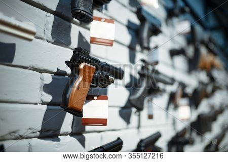 Handguns on showcase in gun shop closeup, nobody