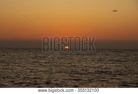 Eautiful Sunny Sunset On The Sea. Amazing Summer View On The Beach.