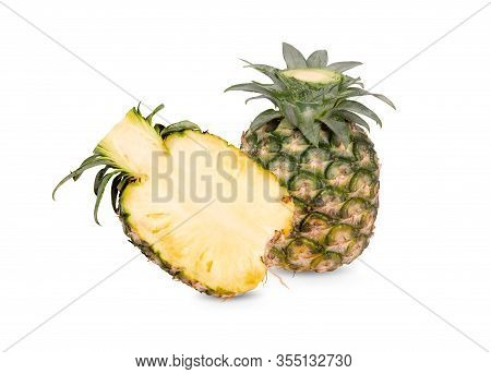Whole And Half Cut Unpeeled Ripe Pineapple On White Background