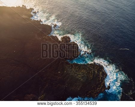 Aerial View Of Lava Cliffs And Ocean With Sunset Light. Lanzarote, Canary Islands.