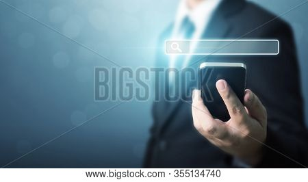 Searching Information Data On Internet Networking Concept. Hand Of Businessman Holding Mobile Smart