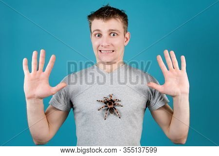 A Young Man Spreads His Arms To The Sides And Expresses The Shock Of The Fact That He Has A Huge Spi