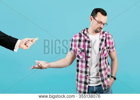 The Guy Reluctantly Agrees To Take The Money And Turns Away From The Man With The Money, Isolated On