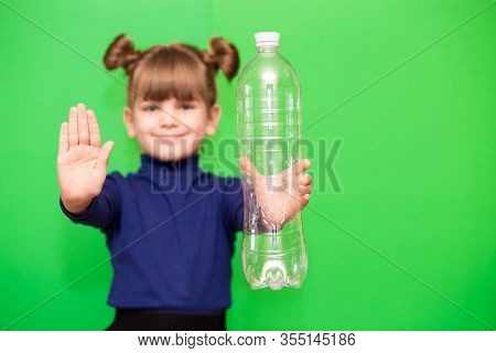 Little Girl With Plastic Bottle And Open Hand Say Stop Of Plastic Pollution, Recycling Plastic, Plas