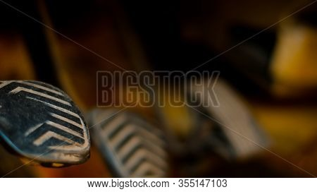 Dirty Brake, Clutch, And Accelerator Gear Shifter Pedal Of Manual Transmission Car. Defocused Backgr