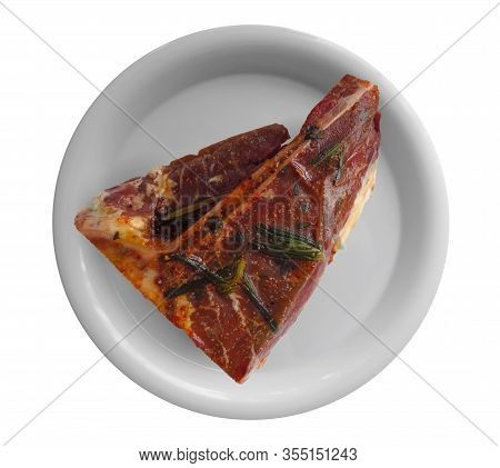 Short Loin Steak On A Dish, Isolated On White Background. Clipping Path Included.