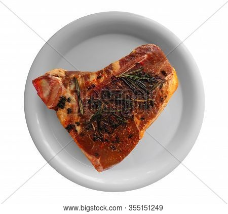 T-bone Steak On A Dish, Isolated On White Background. Clipping Path Included.