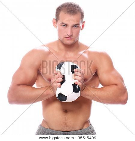 Strong man squeezing soccer ball over white background
