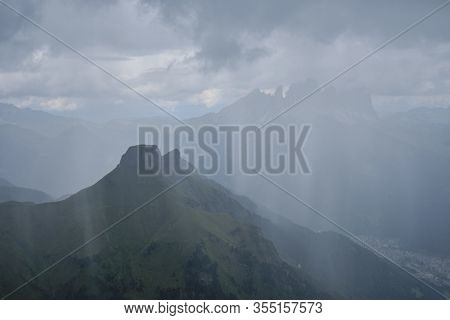 Rain Showers Over Dolomites Mountains, Italy - View During A Storm.