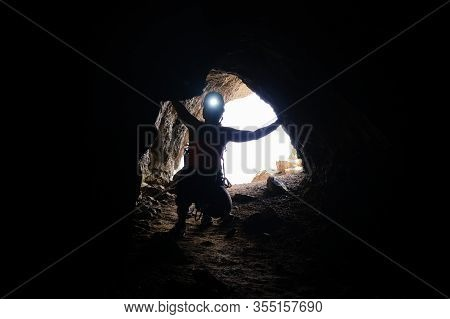 Historic World-war I Tunnel And A Woman Tourist With A Head Torch On, At Via Ferrata Delle Trincee G