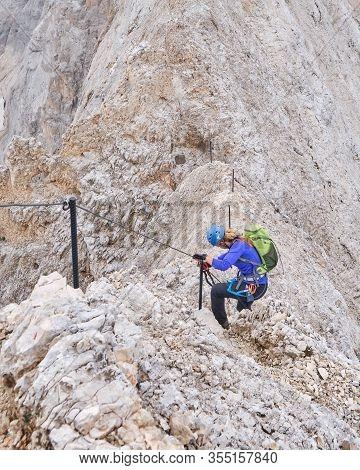 Woman Descending A Ridge Section On Via Ferrata Eterna Brigata Cadore Towards Punta Serauta On Marmo