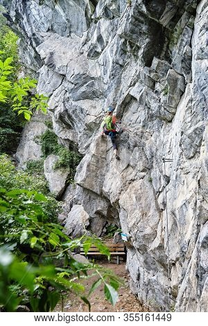 Woman Starting To Climb A Difficult Via Ferrata Route Called Zimmereben (rated D/e), Near Mayrhofen,