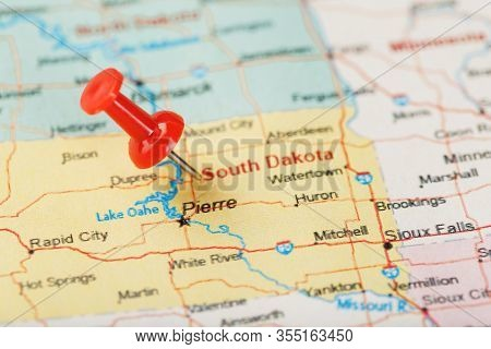 Red Clerical Needle On A Map Of Usa, South Dakota And The Capital Pierre. Close Up Map Of South Dako