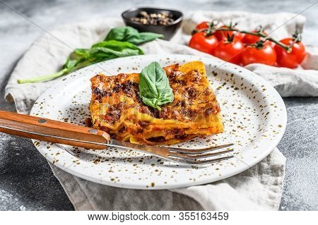 Tasty Portion Of Italian Meat Lasagna With Melted Mozzarella. Gray Background. Top View