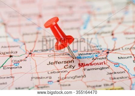 Red Clerical Needle On A Map Of Usa, Missouri And The Capital Jefferson City. Close Up Map Of Missou