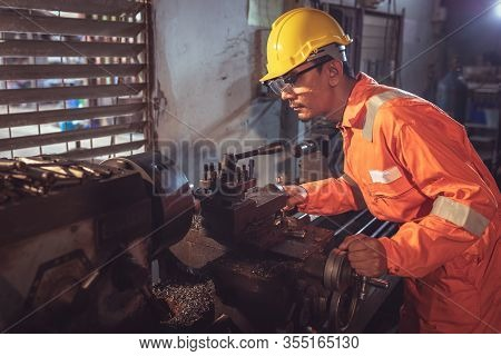 Professional Machinist : Worker Handles Metal At Lathe Operating Lathe Grinding Machine In Uniform W