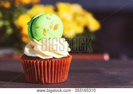 Tasty Cupcake Decorated With Macaroon. Holiday Easter Card. Delicious Easter Cupcake On Table. Sweet