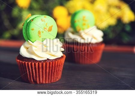 Easter Cupcakes With Macaroons. Delicious Easter Cupcake On Table. Easter French Desserts.