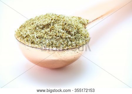 Celery Salt Isolated On White Spoon With Celery Salt In It.