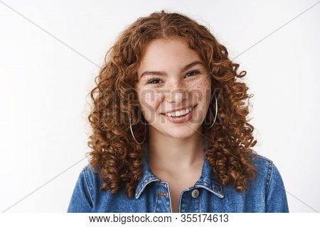 Joyful Friendly-looking Young 20s Girl Student Curly Hair Freckles Pimples Forehead Smiling Broadly
