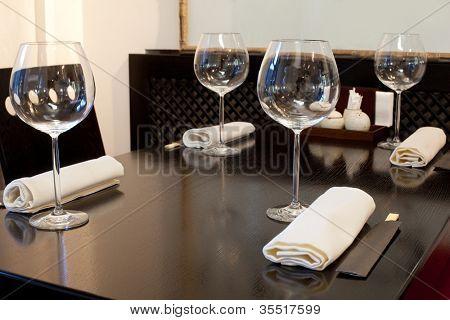 Glasses wine on table in sushi restaurant