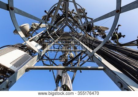 Inside View Of Telecommunication Tower Or Mast With Microwave Equipment, Radio Panel Antennas, Outdo
