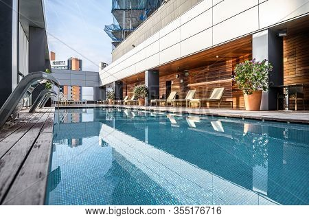 Swimming Pool On Roof Top With Beautiful City View Of The Skyscrapers. . Premium Hotel. 03.01.2020 B