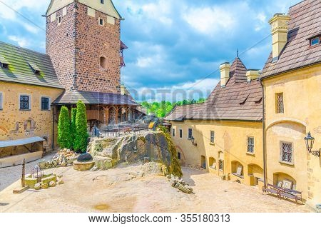 Courtyard Of Medieval Loket Castle (hrad Loket) Gothic Style Building On Massive Rock With Stone Tow