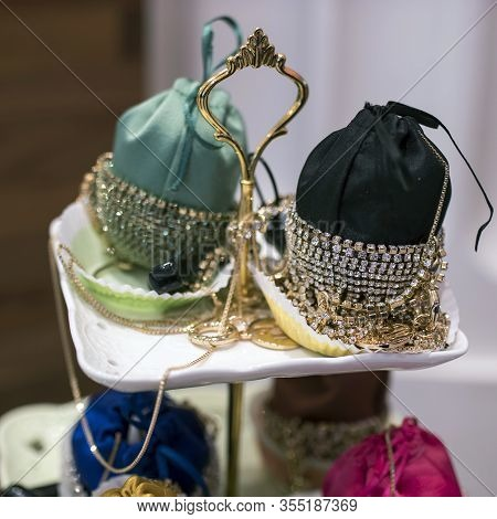 Small Handbags Bordered With Silver Jewelry For Sale In A Store. Baby Holli Mini Crystal-embellished
