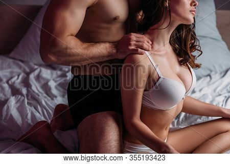 Partial View Of Man Making Neck Erotic Massage To Sexy Girlfriend With Big Breast In Bra