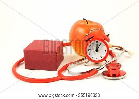 A Red Gift In A Scene Of Healthcare Items For Various Concepts.