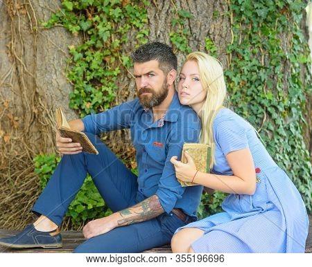 Girl With Pensive Face Listen Bearded Man Reading Poems.