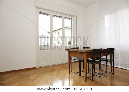 interior, white diningroom, wooden table and black chairs