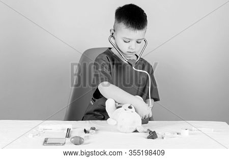 Medicine Concept. Medical Procedures For Teddy Bear. Medical Education. Boy Cute Child Future Doctor