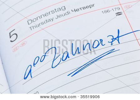 an appointment is entered on a calendar: dentist