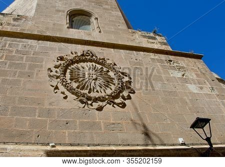Almeria Cathedral, Spain. High On The Wall Is A Carved, Pagan, Sun Emblem, Known By Locals As The So
