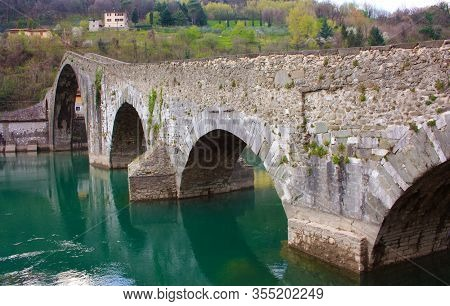 The Suggestive And Famous Ponte Della Maddalena Of Lucca Built In Bricks Over A River In An Ancient