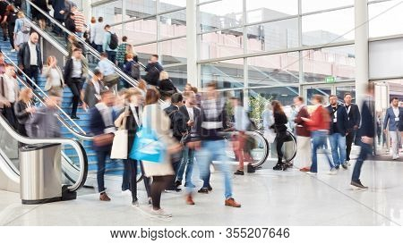 Many anonymous people as a crowd in mall or trade fair