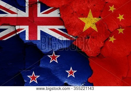 Flags Of New Zealand And China Painted On Cracked Wall