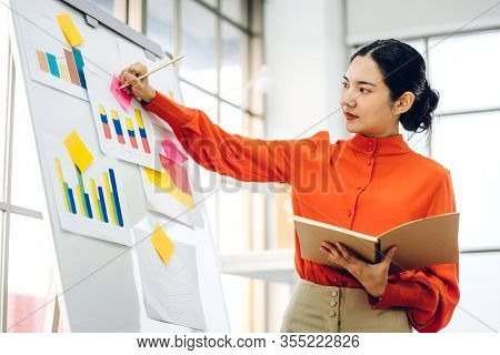 Casual Business Woman Working And Planning Writing Over The Project With Stickers Note On White Boar