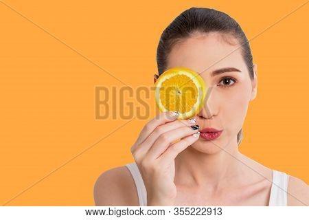 Portrait Of Beautiful Joyful Young Pretty Cute Happy Asian Woman Holding Juicy Orange Fruit Slice Hi