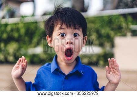 Portrait Of Cute Little Asian Boy Child Fear And Excited Face.kid Felling Shocked And Surprise Expre