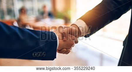 Business lawyers workers meeting at law firm office. Professional executive partners working on finance strategry at the workplace. Shaking hands for succesful agreement.