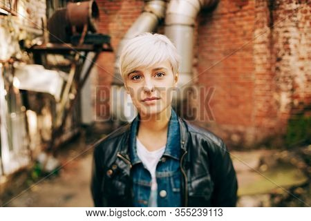 portrait of beautifu blond young woman outdoors