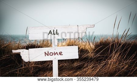 Street Sign The Direction Way To All Versus None