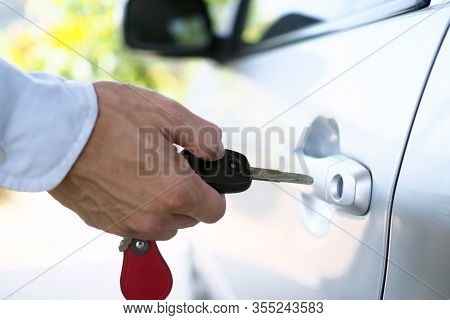 Car Owner With Key. Renting A Car, Buying A Car, Selling A Car Concept