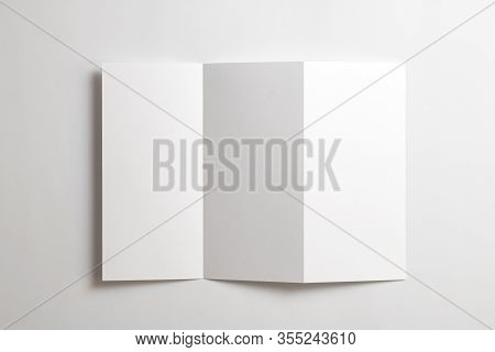Blank Opened Tri Fold Flyer Brochure Isolated On White As Template For Design Presentation, Showcase